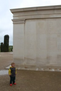 My son standing with the names of those that gave their lives in the Falklands Conflict in 1982 inscribed upon the  Armed Forces Memorial