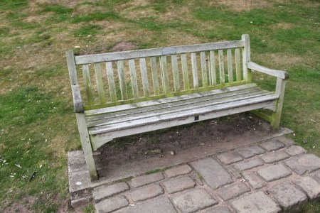 A bench halfway up the hill, just outside the gatehouse of the outer bailey, commemorating a local lady from Bunbury