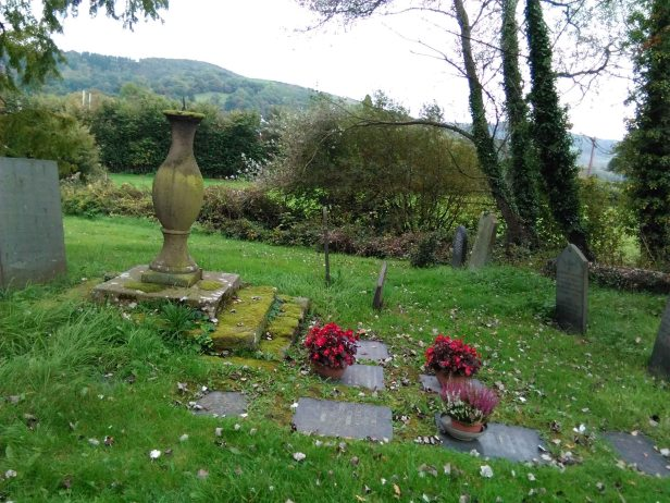 The cremation memorials around the sundial, by the south door of Meifod church